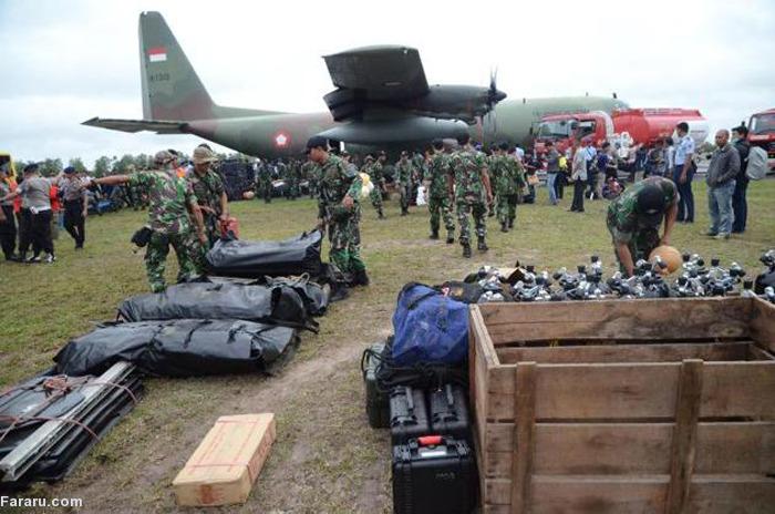(تصاویر) انتقال اجساد قربانیان پرواز اندونزی