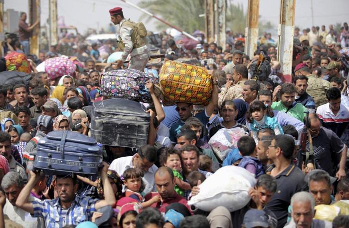 (تصاویر) فرار مردم «الرمادی» از دست داعش
