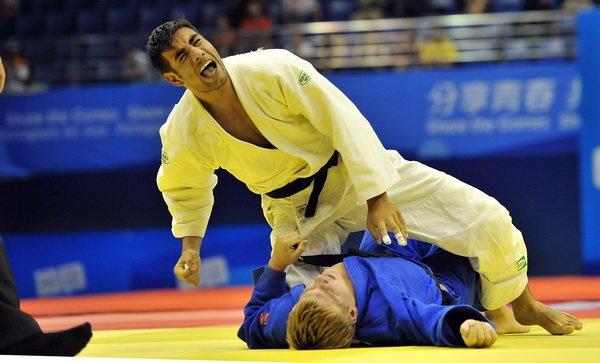 ظرفشویی، عاقبت قهرمان المپیک جودو +(تصاویر)