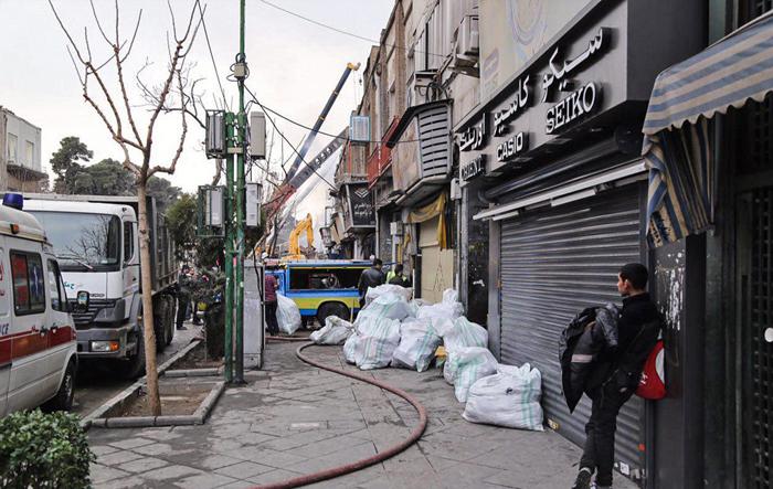 (تصاویر) تخلیه مغازههای مجاور پلاسکو
