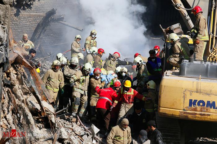 (تصاویر) کشف جسد آتشنشان شهید