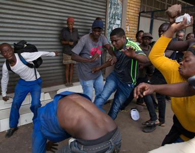 (تصاویر) ضربوشتم مهاجران در افریقایجنوبی