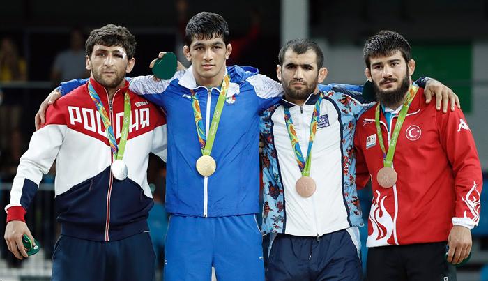 (تصاویر) شاهکاریزدانی با کسب طلای المپیک