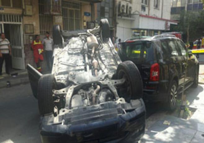 (تصاویر) واژگونی لکسوس در تهران