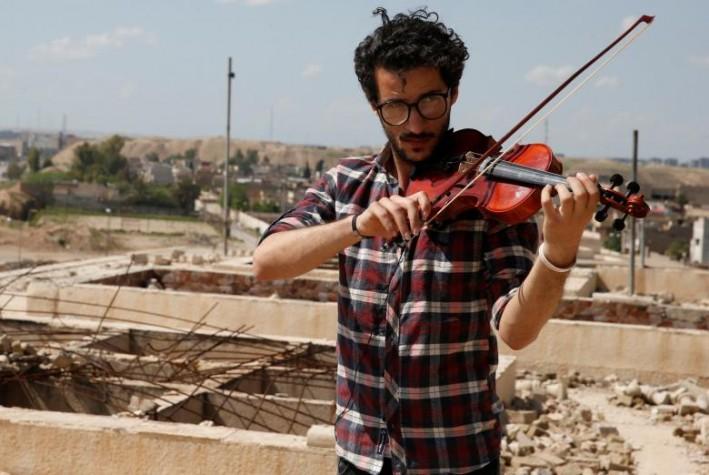 (تصاویر) نوای موسیقی در ویرانههای موصل
