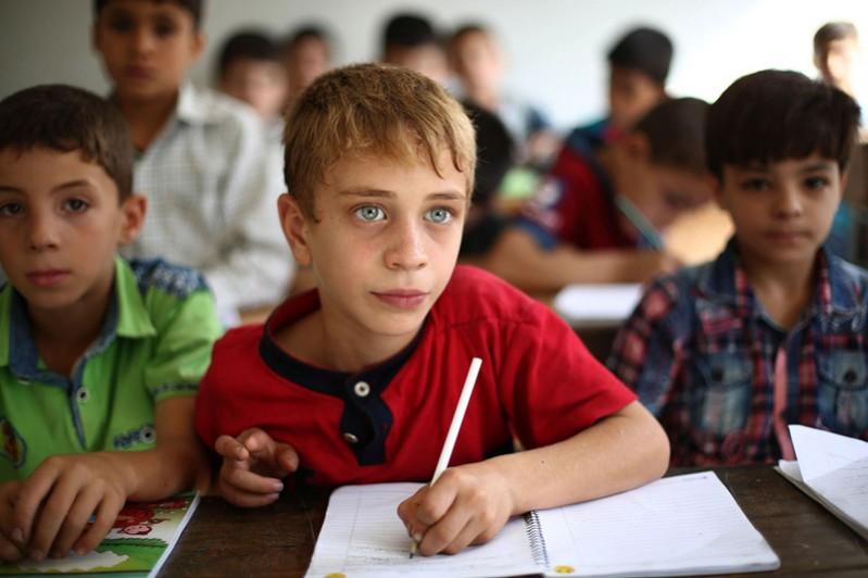 (تصاویر) کودکان سوری و تحصیل در مناطق جنگزده