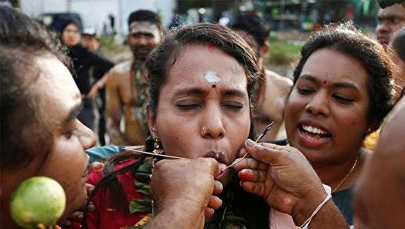 (تصاویر) سوراخ کردن بدن در جشن تایپوسام
