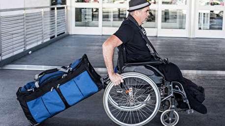 سفر دور دنیای مرد معلول