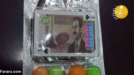 (تصویر) توزیع شیرینی با عکس صدام حسین