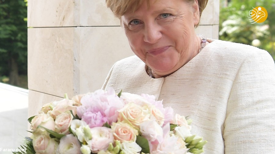 (تصاویر) دسته گل جنجالی پوتین برای مرکل