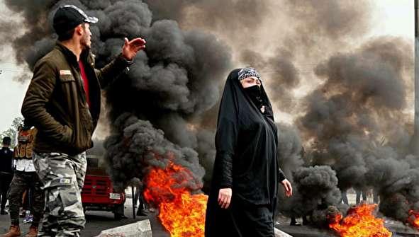 (تصاویر) درگیری نیروهای پلیس با معترضان در بغداد
