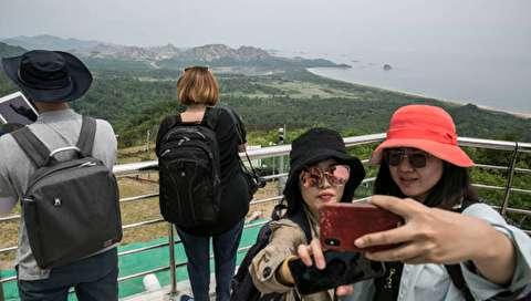 (تصاویر) گردشگران برای نخستین بار در مرز دو کره