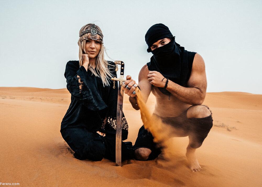 این دختر، به خاطر بن سلمان روی شنهای صحرای سعودی راه میرود!