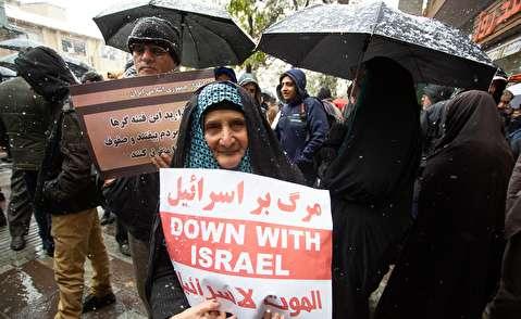 (تصاویر) راهپیمایی علیه آشوبگران در هوای برفی همدان