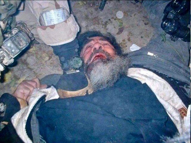 (عکس) تصویری دیده نشده از لحظه دستگیری صدام
