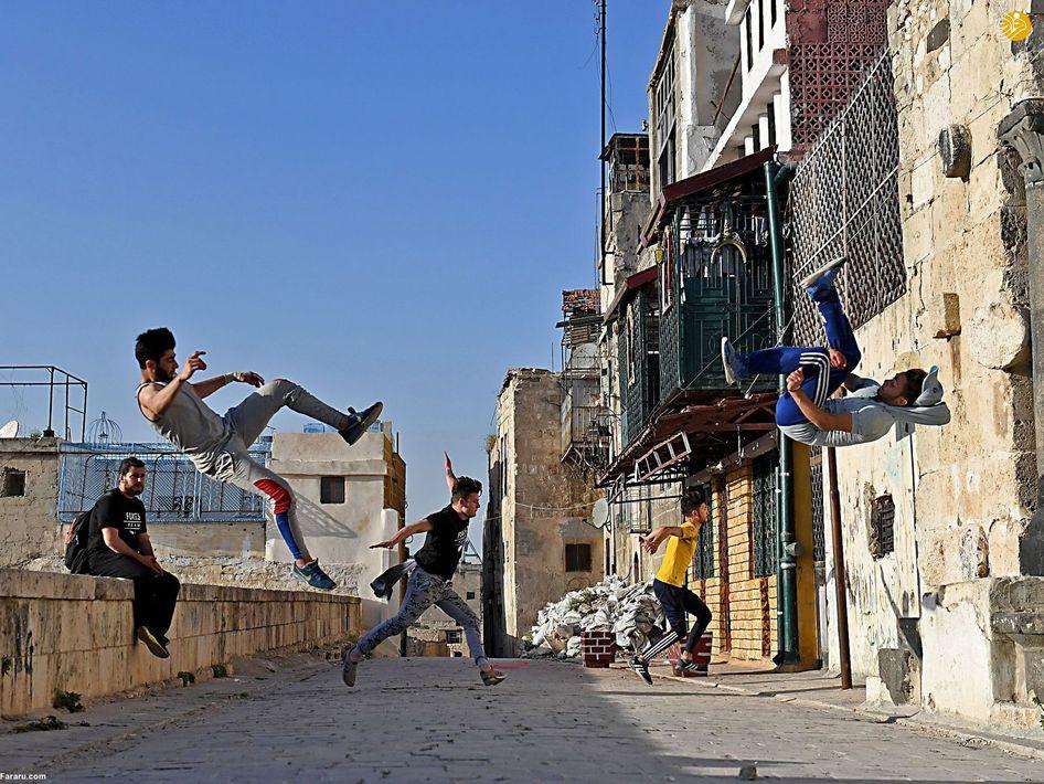 (تصاویر) ورزش پارکور جوانان سوری در ویرانههای حلب|2803146