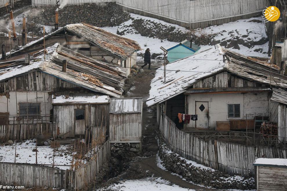 زن کره شمالی در شهر هیسان در مرز چین و کره شمالی