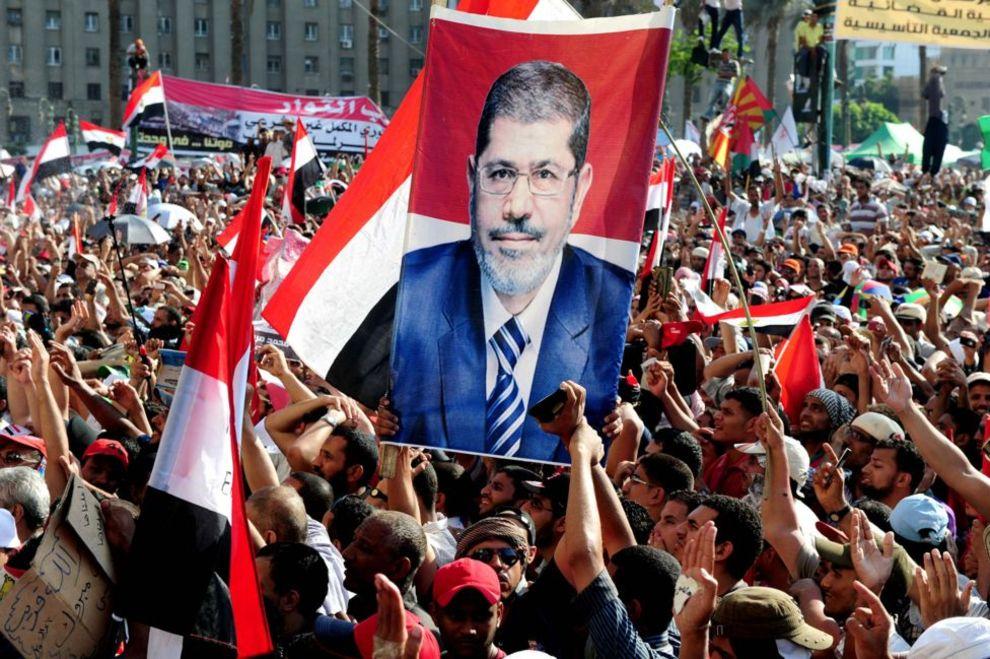 مردم در میدان تحریر قاهره پیروزی محمد مرسی را جشن میگیرند - مصر، ۲۴ ژوئن ۲۰۱۲.